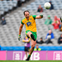 Murphy's Law: Donegal captain Michael Murphy kicks a point despite the best efforts of Kerry defender Paul Murphy. Photo: Sportsfile