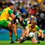 Paul Geaney of Kerry in action against Frank McGlynn, left, and Stephen McMenamin of Donegal. Photo: Sportsfile