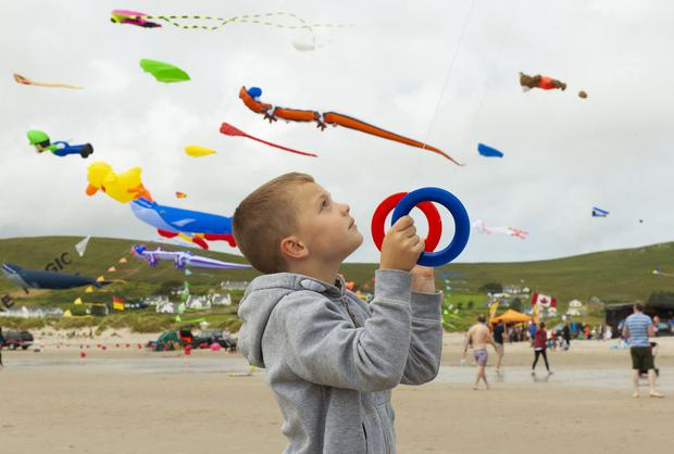 Skygazing: David Korzycki (6) from Castlebar, Co Mayo, was one of hundreds of kite fliers and spectators of all ages. Photo: Michael McLaughlin