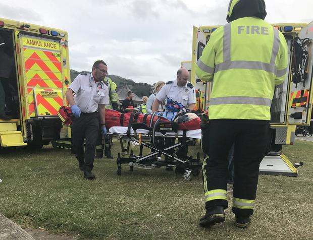 One of the victims is taken to an ambulance. Photo: Celine Naughton