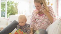 A stay-at-home parent is estimated to carry out 30 hours of childminding, 15 hours of cooking, eight hours of cleaning, five hours of teaching, four hours of handiwork, an hour of gardening and 10 taxi trips a week. Stock Image