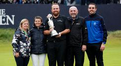 Family pride: Shane Lowry, holding the Claret Jug trophy, with his family after winning The Open. Photo: REUTERS/Ian Walton