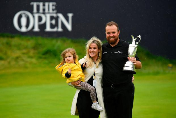 Shane Lowry with wife Wendy and daughter Iris. Photo: Ramsey Cardy/Sportsfile
