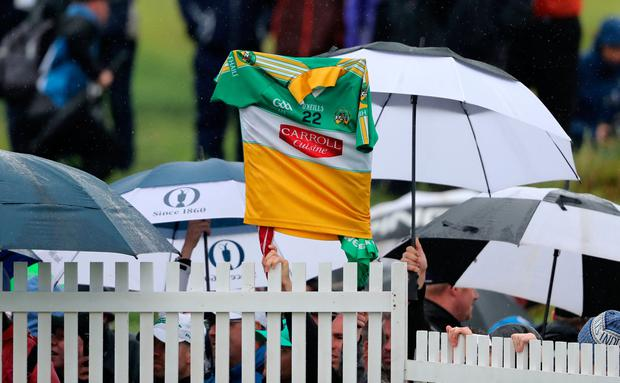 True colours: Fans hold up a Co Offaly GAA jersey in support of Shane Lowry at Portrush yesterday. Photo: PA