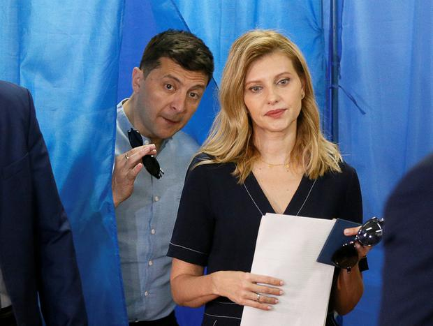 Leader: Ukraine's President Volodymyr Zelenskiy and his wife Olena walk out of a voting booth at a polling station in Kiev. Photo: REUTERS/Valentyn Ogirenko