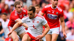 A push too far: Niall Sludden of Tyrone is shoved in the back by Cork's Mattie Taylor as he's about to shoot on goal, resulting in a penalty which Peter Harte fired to the net. Photo: David Fitzgerald/Sportsfile
