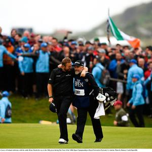21 July 2019; Shane Lowry of Ireland celebrates with his caddy Brian Martin his way to the 18th green during Day Four of the 148th Open Championship at Royal Portrush in Portrush, Co Antrim. Photo by Ramsey Cardy/Sportsfile