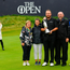 Shane Lowry of Ireland celebrates with his parents Bridget and Brendan Lowry, brother Alan and sister Sinead with the Claret Jug, with his wife Wendy Horner and daughter Iris, left