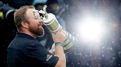 Ireland's Shane Lowry celebrates with the Claret Jug trophy