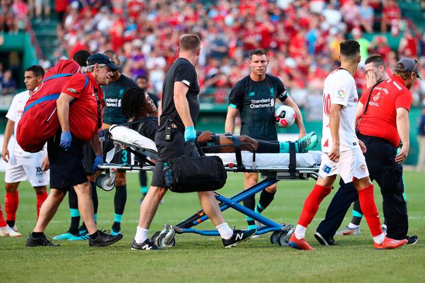 Yasser Larouci of Liverpool is taken off the field on a stretcher