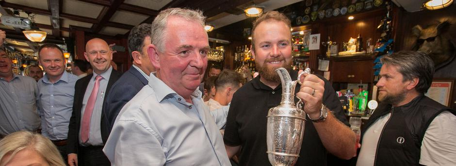 Open champion Shane Lowry is greeted by Boar's Head owner Hugh Hourican