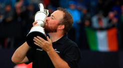 Flying the flag: Shane Lowry's victory in Royal Portrush bridged the North-South divide. Photo by Mike Ehrmann/Getty Images