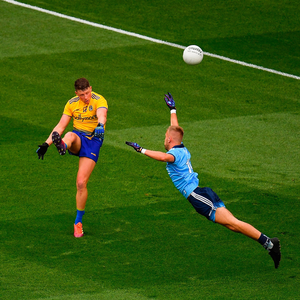 FULL STRETCH: Roscommon's Conor Cox goes for the posts as Dublin's Jonny Cooper closes in last Saturday. Photo by Seb Daly/Sportsfile