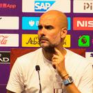 Manchester City manager Pep Guardiola in China