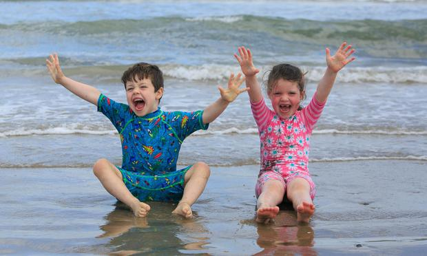 Sophie and Matthew Murphy from Balgriffin enjoying the good weather on Portmarnock Beach, Dublin Photo: Gareth Chaney Collins