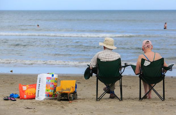 A couple enjoying the good weather on Portmarnock Beach, Dublin Photo: Gareth Chaney Collins