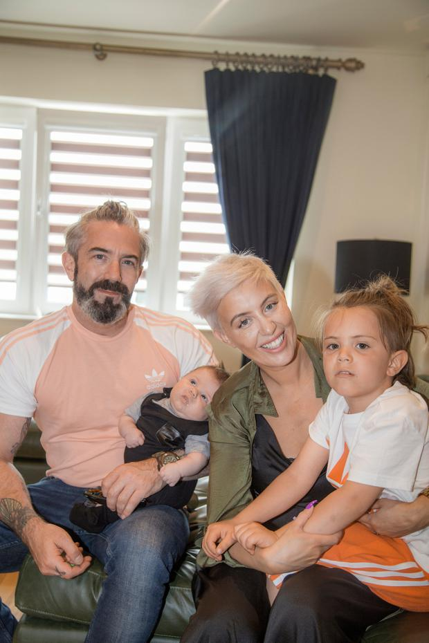 Riley with his mum Aimee, dad Mark, and little brother Frankie