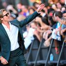 US actor Brad Pitt greets fans as he arrives for the premiere of Sony Pictures'