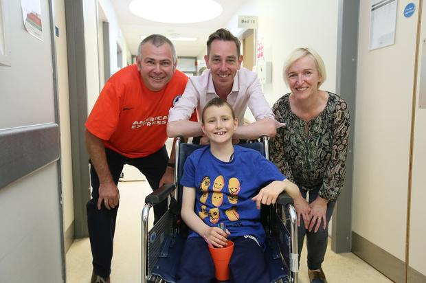 Joseph Ward (9) from Swords with his mum and dad