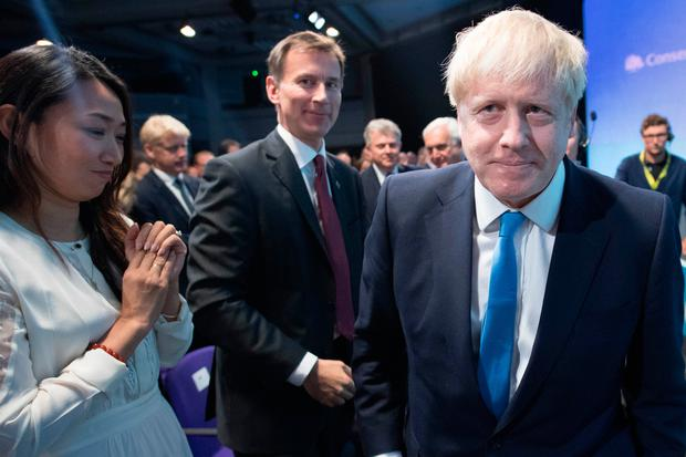 Jeremy Hunt reacts as fellow leadership contender Boris Johnson is elected as the new leader of the Conservative Party and British Prime Minister (Photo by Stefan Rousseau - Pool/Getty Images)