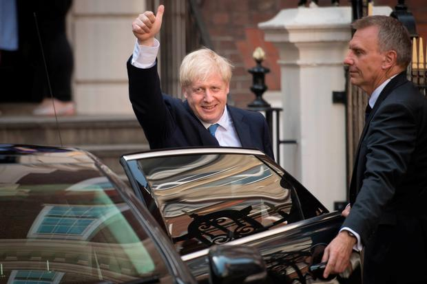 Boris Johnson leaves Conservative party HQ in Westminster, London, after it was announced that he had won the leadership ballot and will become the next Prime Minister. Stefan Rousseau/PA Wire