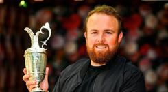 Familiar pose: Shane Lowry shows the Claret Jug off to media ahead of his homecoming in Offaly. Photo: Sam Barnes/Sportsfile