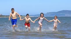Big splash: Cooling down at Sandymount are Dylan Houlihan (12) with Braxton Burke (7), Scottlyn Hallion (6) and Pippie Fay (4), all from Dublin. Photos: Frank McGrath & Gareth Chaney