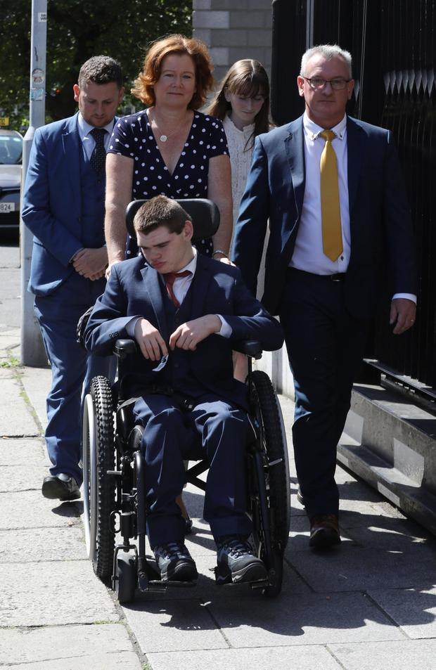 Loving: Samuel Forde leaving the Four Courts with parents Deborah and Des, sister Hannah and solicitor David O Malley. Photo: Collins