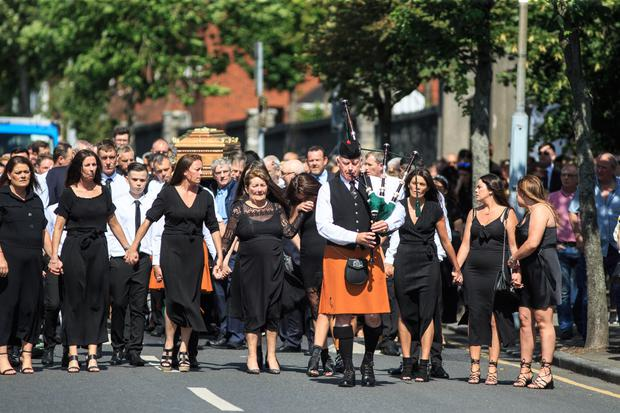 Poignant: The coffin of John Hutch is brought to the Church of the Holy Family, Aughrim Street, in Dublin.