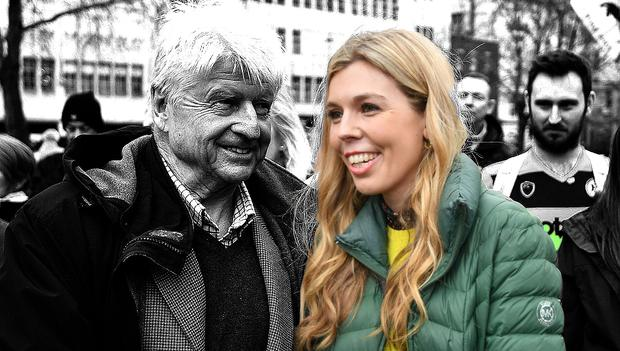Stanley Johnson, left, introduces himself to Carrie Symonds at an anti-whaling protest outside the Japanese Embassy in central London. (Photo by John Stillwell/PA Images via Getty Images)