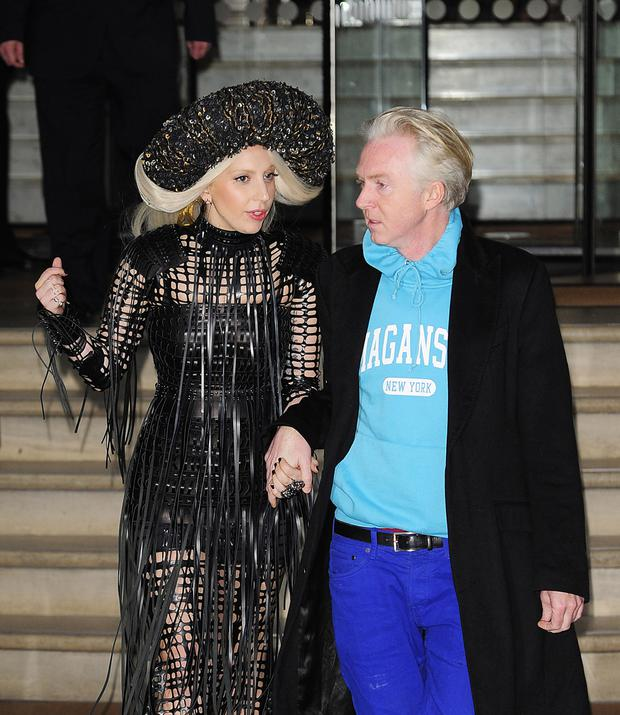 Lady Gaga, wearing a Margaret O'Connor headpiece, and hat designer Philip Treacy, in 2013