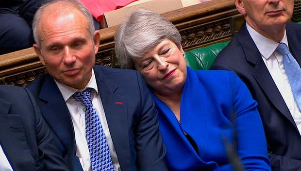 UK Prime Minister Theresa May leans on the Minister for the Cabinet Office David Lidington during her last Prime Minister's Questions in the House of Commons, London. House of Commons/PA Wire