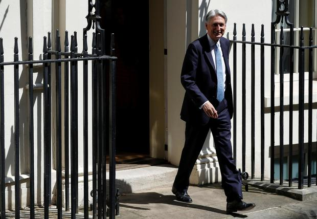 Chancellor of the Exchequer Philip Hammond leaves his Downing Street home for one of the last times. July Photo: REUTERS/Peter Nicholls