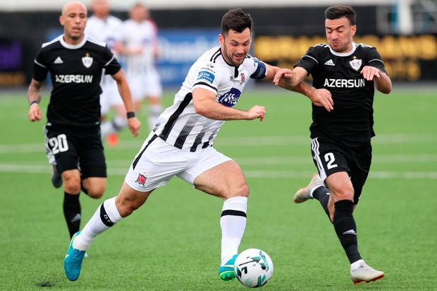 Dundalk's Patrick Hoban (left) and Qarabag's Gara Garayev battle for the ball during the UEFA Champions League second qualifying round first leg match at Oriel Park, Dundalk. Photo credit: Brian Lawless/PA Wire