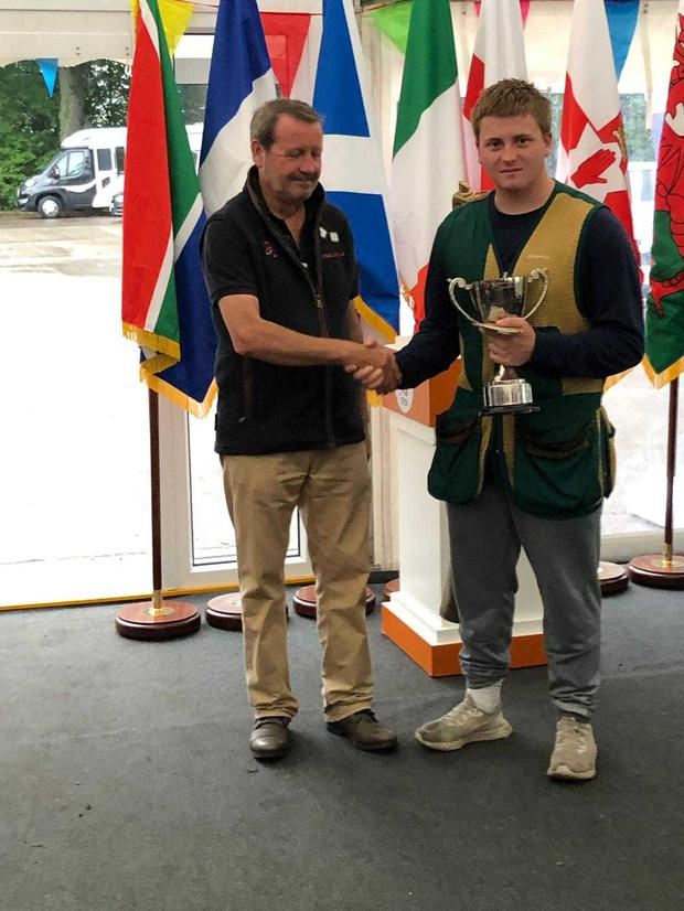 Eli Dunphy accepts the British Open Junior (under 21) Clay Target Championships trophy