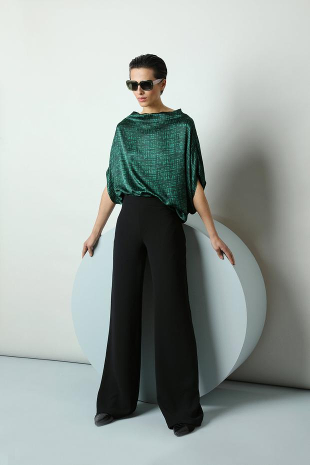 'Stella' silk forest green and black grid print tunic, €325, 'Sadie' wide-leg black woven crepe trousers, €225; 'Maeve' fern green sunglasses, €350, from the Wolfhound Eyewear range available at Optica, Dawson Street, Dublin 2