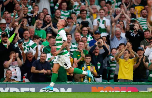 Celtic's Leigh Griffiths celebrates scoring his sides 3rd goal during the UEFA Champions League second qualifying round match at Celtic Park, Glasgow. Photo credit: Andrew Milligan/PA Wire