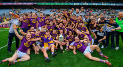 Wexford players, here celebrating with the Bob O'Keeffe Cup after their Leinster final win over Kilkenny, will know they have to step up another level against Tipp. Photo: Sportsfile