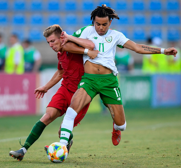 Tyreik Wright of Republic of Ireland and Costinha of Portugal contend for the ball. Photo: Stephen McCarthy/Sportsfile
