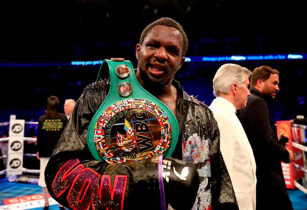 Dillian Whyte celebrates victory after defeating Oscar Rivas on points in the WBC interim Heavyweight title fight at the O2 Arena, London.