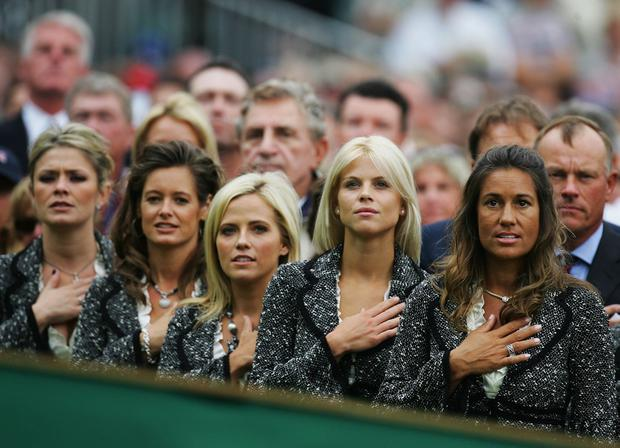 Amy Campbell (L),Tabitha Furyk, Amy Mickelson, Elin Woods and Melissa Lehman (R) observe their country's national anthem during the Opening Ceremony of the 2006 Ryder Cup at The K Club on September 21, 2006 in Straffan, Co. Kildare, Ireland. (Photo by David Cannon/Getty Images)
