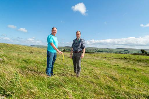 James McDonnell with Stephen Flanagan, CAFRE Beef and Sheep adviser assessing grass covers in paddocks on land at 350m outside Glenarm.