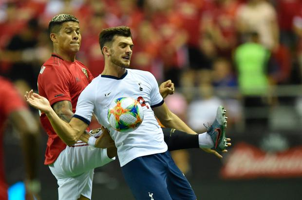 Manchester United's Marcos Rojo (L) fights for the ball with Tottenham's Troy Parrott (R) during the International Champions Cup football tournament between English Premier League sides Manchester United and Tottenham at Hongkou Football Stadium in Shanghai on July 25, 2019. (Photo by HECTOR RETAMAL / AFP)
