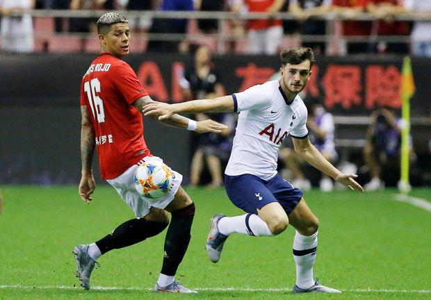Tottenham Hotspur's Troy Parrott in action with Manchester United's Marcos Rojo