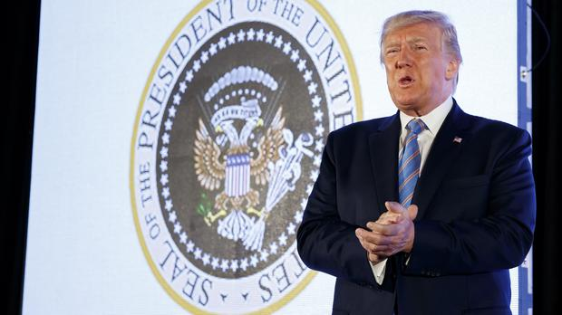 Donald Trump speaks in front of the altered presidential seal at Turning Point USA's Teen Student Action Summit 2019 (Alex Brandon/AP)