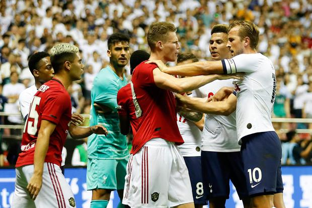 TEMPERS FRAYED: Players square off during the International Champions Cup match between Tottenham Hotspur and Manchester United at the Shanghai Hongkou Stadium. Photo: Getty Images
