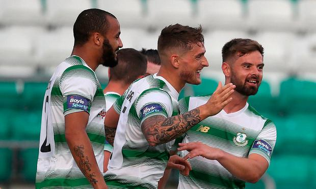 CONGRATS: Lee Grace (c) is surrounded by team-mates after grabbing the home side's first goal at Tallaght Stadium. Photo: PA