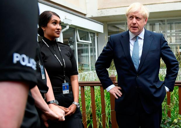 Campaign mode: Boris Johnson spoke to police cadets and pressed the flesh with locals in Birmingham yesterday as he promised to recruit 20,000 more officers to combat crime. Photo: PA