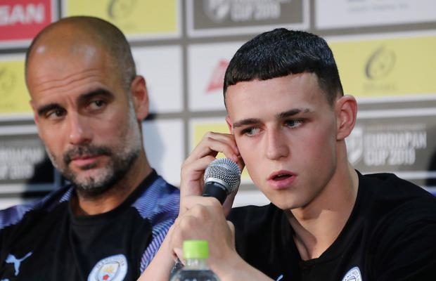 City boss Pep Guardiola and Phil Foden