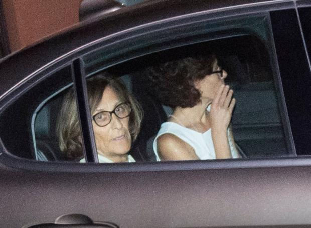 Prosecutor Nunzia D'Elia, left, leaves a Carabinieri police station, in Rome, after questioning two young American tourists, early Saturday morning, July 27, 2019. A young American tourist has confessed to fatally stabbing an Italian paramilitary policeman who was investigating the theft of a bag and cellphone before dawn Friday, (Claudio Peri, Giuseppe Lami/ANSA via AP)